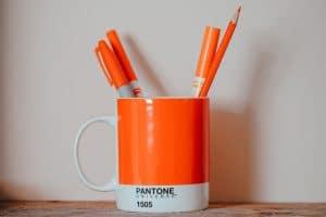 Orange pens in orange mug